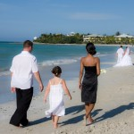 Walking on the beach in cuba with wedding party
