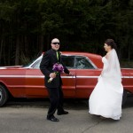 bride groom and classic red car