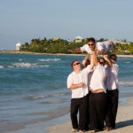 groomsmen and groom on beach in cuba