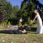 bride tees off with golf ball in grooms mouth