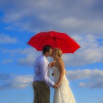 Romantic Kiss under a red umbrella