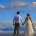 bride and groom enjoying a beautiful sky and mountain view