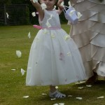 flower girl walking down aisle at Victoria Yacht Club