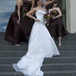 bridal party posing on the steps of the Delta Ocean Point Inn