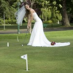 bride playing mini golf in Beacon Hill Park