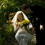 bride adjusting bouquet at finnerty gardens at Uvic