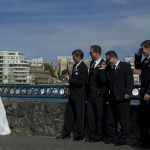 a bride and groomsmen at Delta Ocean Point Resort in the inner harbour