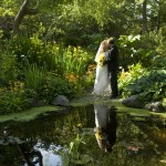 reflection of bride and groom at Finnerty Gardens