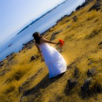 bride walking towards the ocean