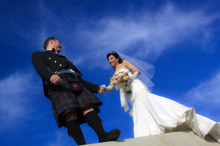 portrait of bride and groom at breakwater
