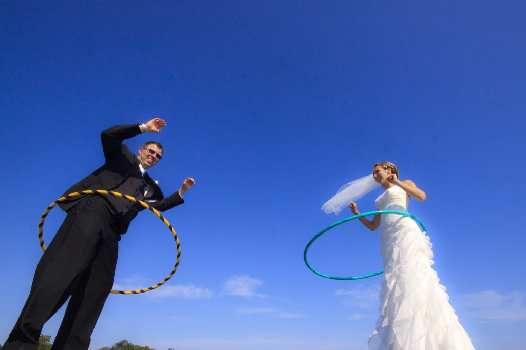 wedding portrait of a bride and groom with hoola hoops