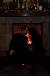 picture of a couple in front of a fireplace